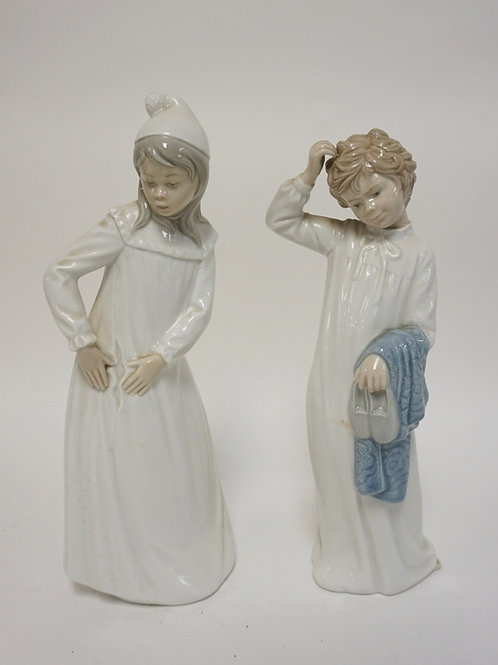 PAIR OF LLADRO NAO FIGURES- CHILDREN IN NIGHTGOWNS. TALLEST 11 3/4 IN