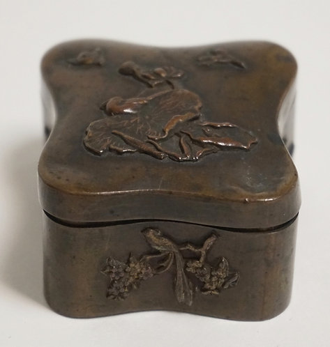 SMALL ASIAN BRONZE BOX. DECORATED WITH BIRDS AND FLOWERS. 2 3/8 X 2 1/8 AND 1 1/