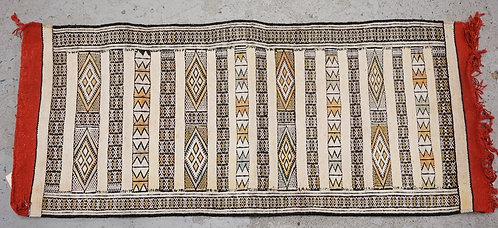 MOROCCAN RUG MEASURING 4 FT X 1 FT 8 INCHES.