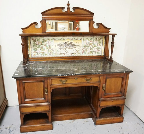 CARVED SIDEBOARD WITH BLACK MARBLE TOP AND A TILE BACK WITH WADING BIRDS AND PIN