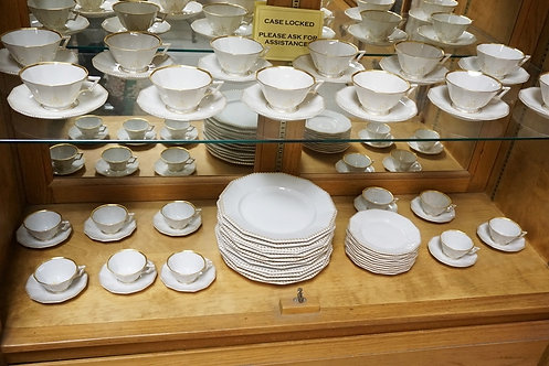 66 PIECE NYMPHENBURG DINNERWARE SET WITH GOLD TRIM. PARGEST PLATES ARE 9 1/2 INC
