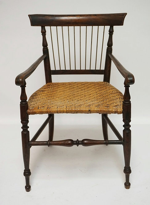 CHILD'S OR DOLL SIZED ARMCHAIR WITH A CANED SEAT AND TURNED LEGS. 19 3/4 INCHES