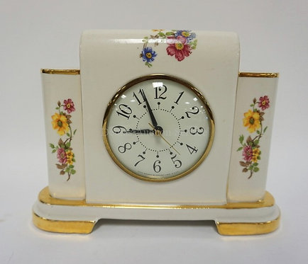 SESSIONS ELECTRIC MANTEL CLOCK DECORATED WITH FLOWERS. 7 3/4 INCHES HIGH.
