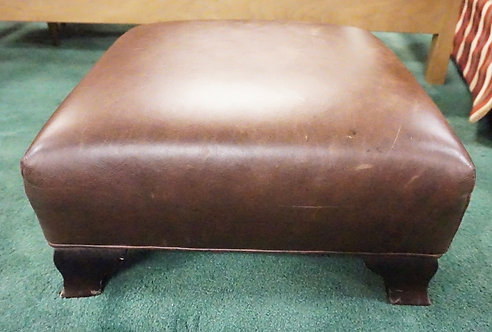 LEATHER FOOTSTOOL. 19 INCHE SQUARE. 9 INCHES HIGH.
