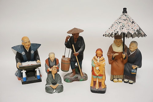 LOT OF 5 HAKATA URASAKI CERAMIC DOLLS. TALLEST IS 15 1/2 INCHES.