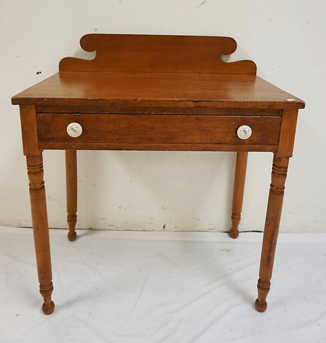 ANTIQUE ONE DRAWER STAND WITH TURNED LEGS AND A SCROLL CUT BACKSPLASH. 30 INCHES