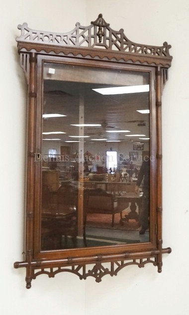 MAHOGANY HANGING CORNER CABINET WITH A FRETWORK CREST AND SKIRT. 24 INCHES WIDE.