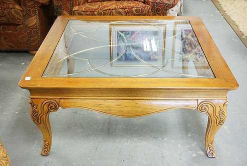 CARVED COFFEE TABLE WITH A BRASS INLAID TOP AND A SECOND FLAT GLASS ON TOP. 44 I