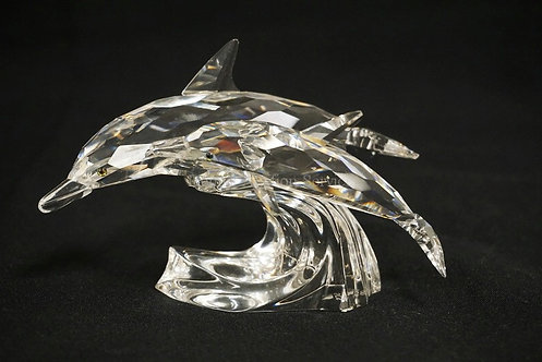 SWAROVSKI CRYSTAL DOLPHIN FIGURE MEASURING 4 5/8 INCHES LONG AND 3 INCHES HIGH.