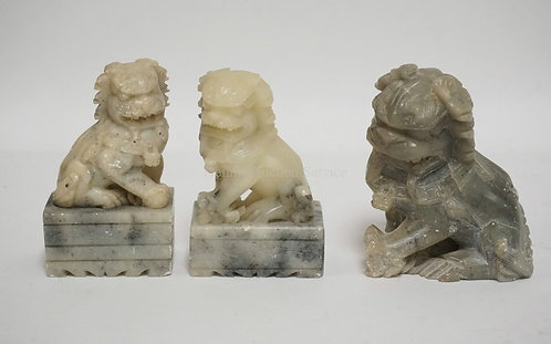 3 ASIAN CARVED STONE FIGURES OF FOO DOGS. 3 1/2 INCHES HIGH.