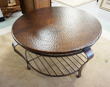 ROUND METAL COFFEE TABLE WITH A FAUX HAMMERED TOP. 36 INCH DIA.