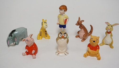 SET OF 8 WALT DISNEY WINNIE THE POOH FIGURES BY BESWICK. TALLEST IS 4 3/4 INCHES