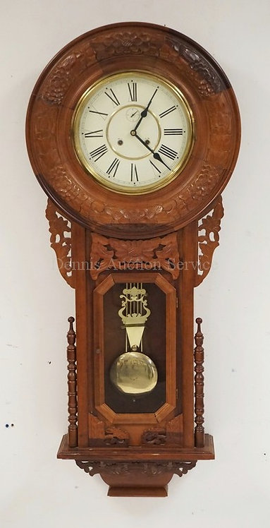CONTEMPORARY REGULATOR CLOCK IN A CARVED CASE. APPROX 51 INCHES LONG.