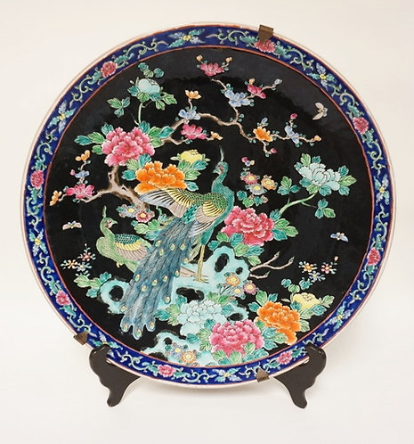 COLORFUL SIGNED ASIAN CHARGER WITH 2 PEACOCKS IN A FLOWERING TREE. 18 IN DIAMETE