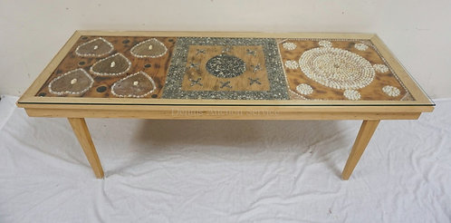 CUSTOM MADE COFFEE TABLE HAVING 3 PANELS UNDER GLASS CONSISTING OF AFRICAN SHELL