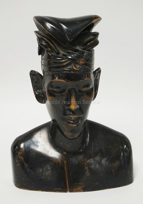 CARVED WOODEN ETHNIC SCULPTURE MEASURING 10 1/4 INCHES HIGH.