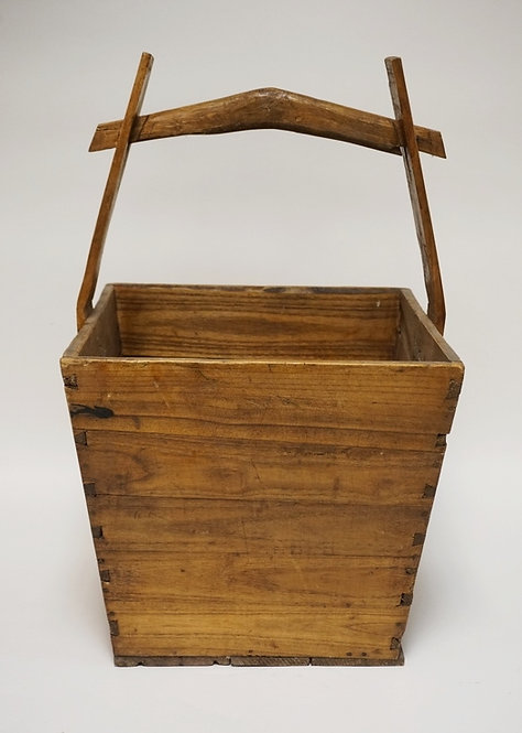 ASIAN WOODEN BASKET HAVING DOVETAILED CONSTRUCTION AND A CARVED HANDLE. 24 1/2 I