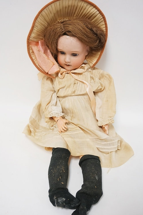 BISQUE HEAD DOLL MARKED MB IN A CIRCLE. 20 IN