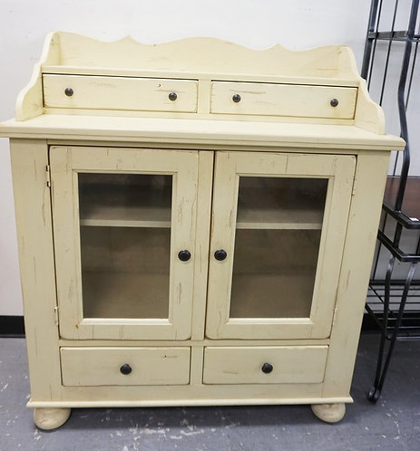 CABINET IN OFF WHITE PAINT. 2 GLASS PANED DOORS WITH 2 DRAWERS BELOW.