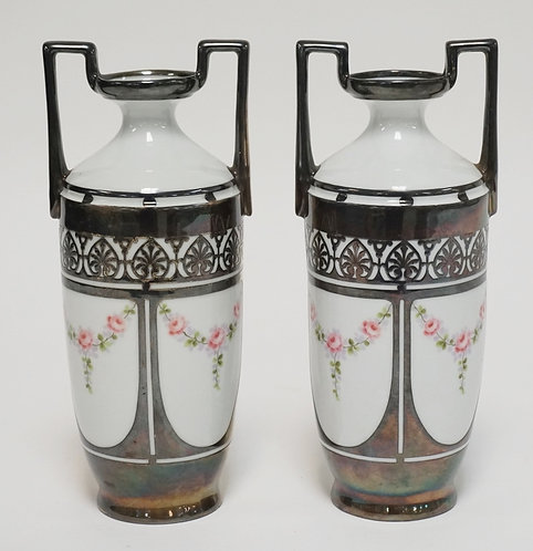 PAIR OF HAND PAINTED SILVER OVERLAY PORCELAIN VASES WITH HIGH HANDLES. UNMARKED.