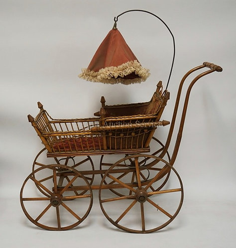 EARLY 20TH CENTURY VICTORIAN STYLE DOLL CARRIAGE, 26 INCHES TALL, 28 INCHES FROM