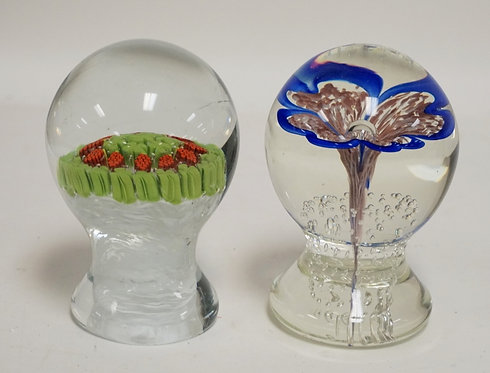 LOT OF 2 ART GLASS PEDESTAL FOOTED PAPERWEIGHTS. INTERNALLY DECORATED. 4 3/4 INC