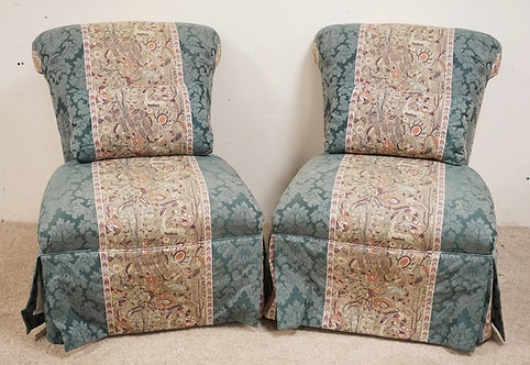 PAIR OF BROCADE UPHOLSTERED SLIPPER CHAIRS WITH MATCHING PILLOWS.