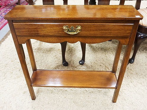 ONE DRAWER STAND WITH BRASS HARDWARE. 28 INCHES HIGH. 28 INCHES WIDE.