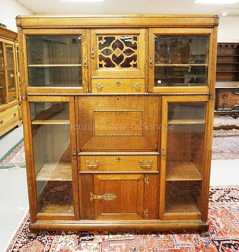 OAK BOOKCASE CABINET WITH 5 GLASS DOOR CABINETS, 2 DRAWERS, AND A DROP FRONT DES