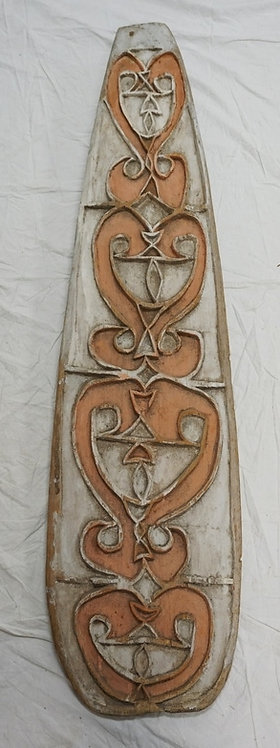 AFRICAN CARVED WOODEN SHIELD MEASURING 55 INCHES LONG.