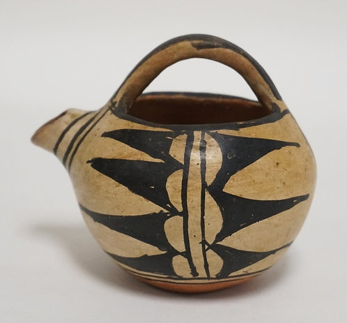 NATIVE AMERICAN INDIAN RED POTTERY VESSEL WITH A HANDLE AND A SPOUT. 3 5/8 INCHE