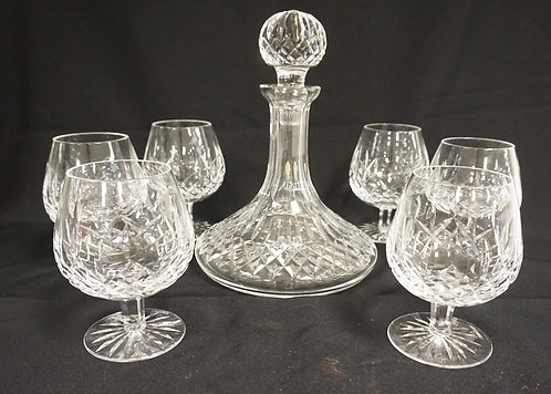 WATERFORD LISMORE CAPTAINS DECANTER WITH SIX 5 1/4 IN GOBLETS. DECANTER IS 9 3/4