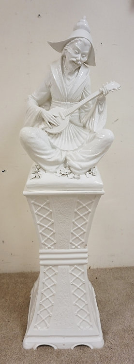 ASIAN PORCELAIN SCULPTURE WITH PEDESTAL. 56 INCHES HIGH.