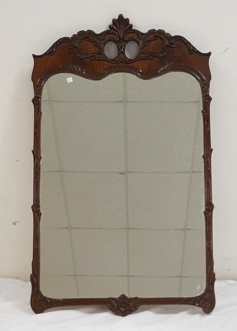CARVED MAHOGANY MIRROR MEASURING 28 1/4 X 47 INCHES.