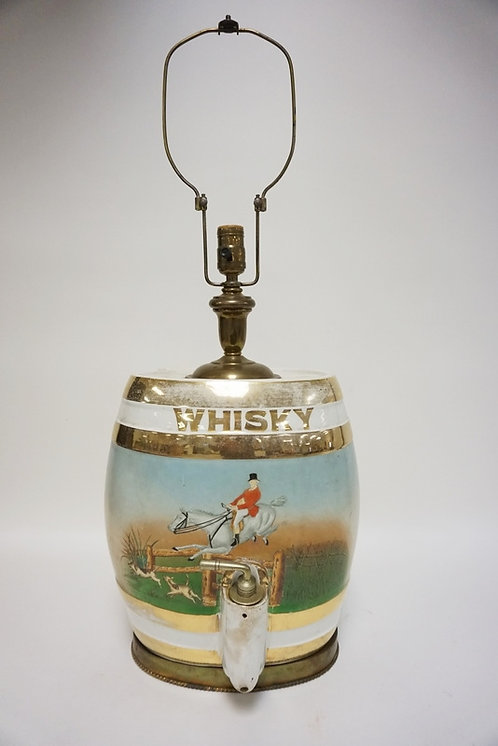PORCELAIN WHISKEY DISPENSER WITH HAND PAINTED HUNT SCENE MADE INTO A LAMP. 30 1/