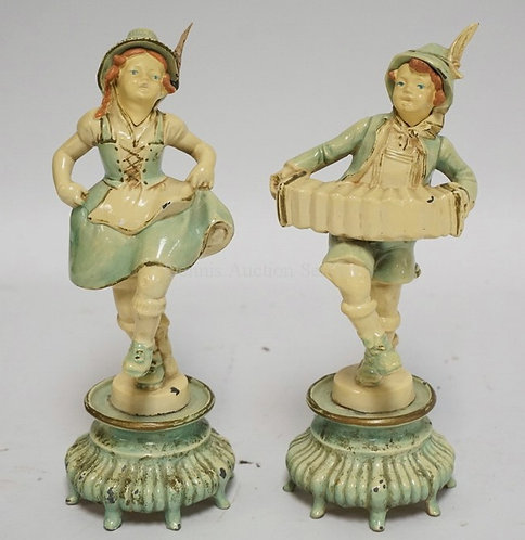 PAIR OF WHITE METAL FIGURES WITH ORIGINAL THICK ENAMEL PAINT. A BOY PLAYING AN A