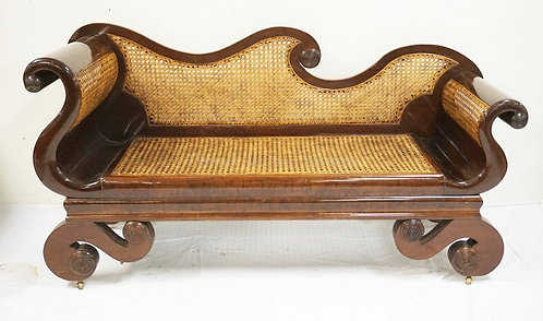 UNUSUAL EMPIRE MAHOGANY SETTE WITH CANED SEAT, BACK, AND SIDES. SCROLLED ARMS AN