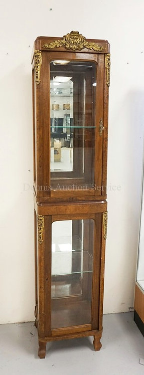 2 SECTION BRONZE MOUNTED DISPLAY CABINET. BEVELED GLASS DOORS AND SIDES WITH GLA