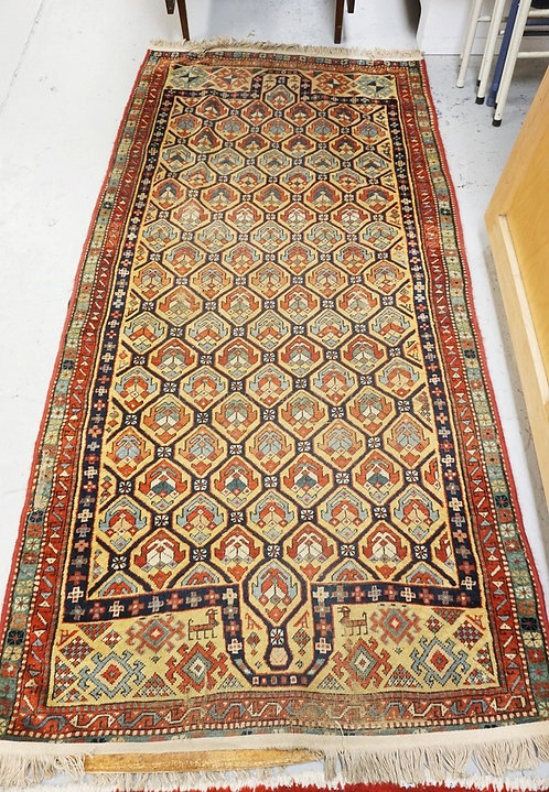 ANTIQUE ORIENTAL RUG MEASURING 3 FT 4 INCHES X 7 FEET. GEOMETRIC ELEMETS ALONG W