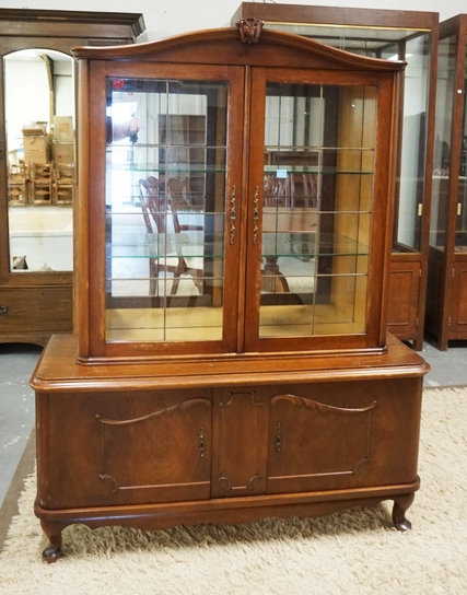 2 PIECE CHINA CABINET WITH APPLIED CARVINGS. 66 3/4 INCHES HIGH. 50 1/2 INCHES W