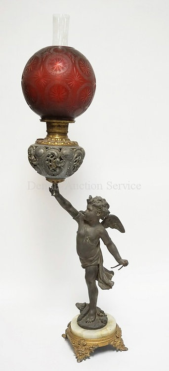 ANTIQUE FIGURAL OIL LAMP HAVING A FULL BODIED CUPID FIGURE WITH AN ONYX AND GILT