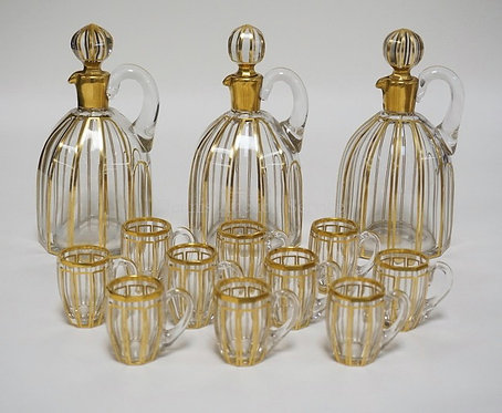SET OF BLOWN CRYSTAL DECANTERS WITH 10 CORDIAL MUGS. ALL PANEL CUT WITH APPLIED