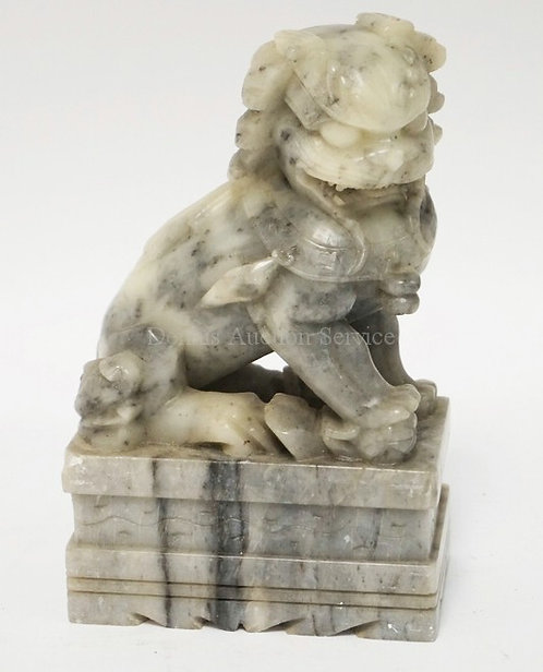 CARVED STONE FOO DOG MEAURING 7 INCHES HIGH.