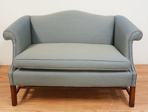 1030_UPHOLSTERED SETTEE WITH CHIPPENDALE LEGS. 57 INCHES WIDE.