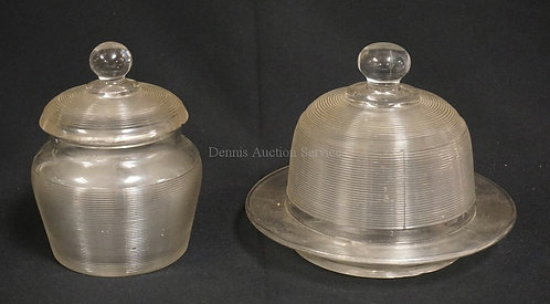 2 PIECE OF EARLY GLASSWARE. A COVERED BUTTER AND A COVERED JAR. EACH WITH CHIPPI