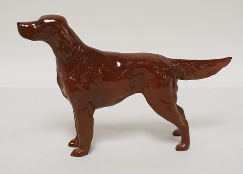 BESWICK PORCELAIN FIGURE OF A DOG. 5 1/2 INCHES HIGH.