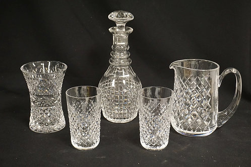 5 PIECE LOT OF WATERFORD CRYSTAL. INCLUDES A 10 3/4 INCH DECANTER, PITCHER, VASE