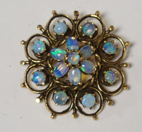 10K GOLD AND OPAL BROOCH MEASURING 1 1/8 INCH IN DIA. 4.0 DWT. UNMARKED & TESTED