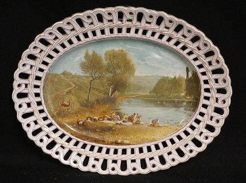 HAND PAINTED PORCELAIN OVAL TRAY WITH A RETICULATED BORDER. A SCENE IN THE CENTE