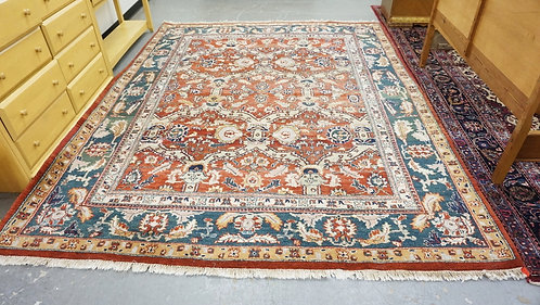 ROOM SIZE HAND WOVEN WOOL ORIENTAL RUG MEASURING 7 FT 10 X 9 FT 10 INCHES.